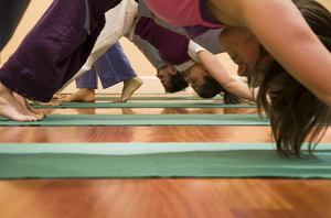 Downward dog in an Ashtanga Yoga Class