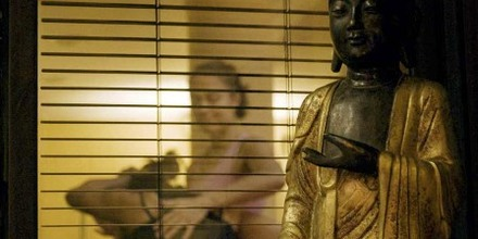 Buddha looks on as desiree corrects Ashtanga class.jpg